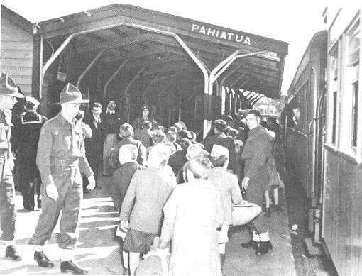 (19) The welcoming party of New Zealand soldiers on the platform of Pahiatua Railway Station on November 2, 1944.  They helped the children with their luggage onto waiting army trucks that took them to their new home.