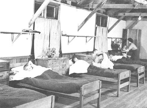 (20) The first night in what was to be the children's home for the next few years.  The Pahiatua Red Cross Society prepared all the dormitories just before the children arrived.  There were fresh flowers on the tallboys and friendly members of the New Zealand Women's Army Corps to help the small children into bed.